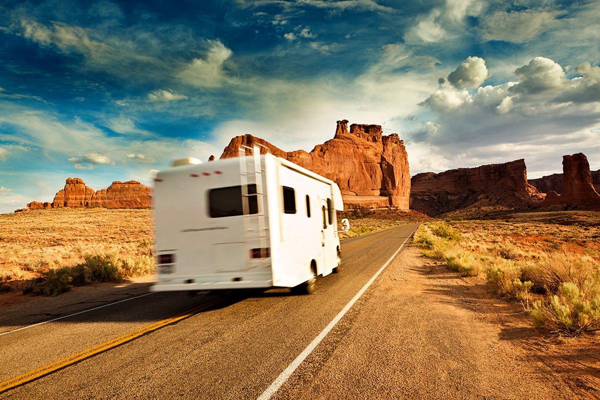 A motorhome travels through Arches National Park, Utah.